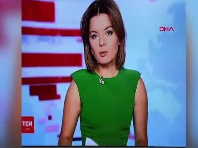 Ukrayna'da haber spikerinin ön dişi canlı yayında düştü